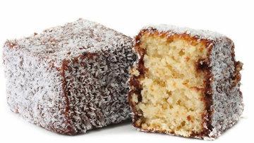 Ламингтон - это пирожное из бисквита, в шоколадной глазури с кокосовой посыпкой